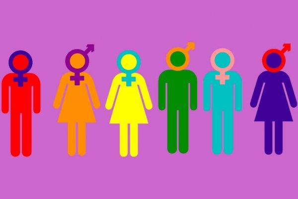Bunte Piktogramm-Figuren mit LGBTQ-Symbolen als Köpfen